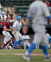 STANFORD, CA - April 23, 2011: Zach Jones of Stanford baseball applies the tag on a botched suicide squeeze play to end the inning during Stanford's game against UCLA at Sunken Diamond. Stanford won 5-4.