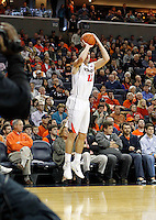 Virginia guard Joe Harris (12) shoots a three point basket during the second half of an NCAA basketball game Saturday Jan. 18, 2014 in Charlottesville, VA. Virginia defeated Florida State 78-66. (AP Photo/Andrew Shurtleff)