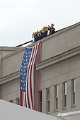 Arlington, VA - September 11, 2008 -- First responders stand atop the Pentagon during the Pentagon Memorial dedication ceremony Sept. 11, 2008, at the spot where American Airlines Flight 77 crashed into the building on Sept. 11, 2001, killing 59 people aboard the flight and 125 in the building. First responders are the firefighters, police officers and other rescue workers who were first on the scene that day..Credit: Andy Morataya - DoD via CNP
