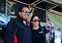 Oct. 26, 2012; Las Vegas, NV, USA: NHRA funny car driver Alexis DeJoria (right) with Cruz Pedregon during qualifying for the Big O Tires Nationals at The Strip in Las Vegas. Mandatory Credit: Mark J. Rebilas-