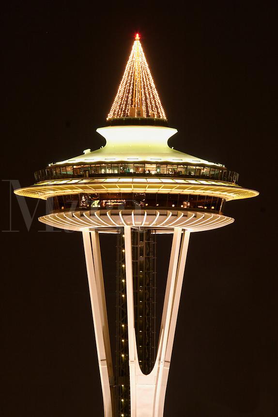 Nighttime scene of top half of Seattle Space Needle, Seattle Center, Seattle, Washington, US