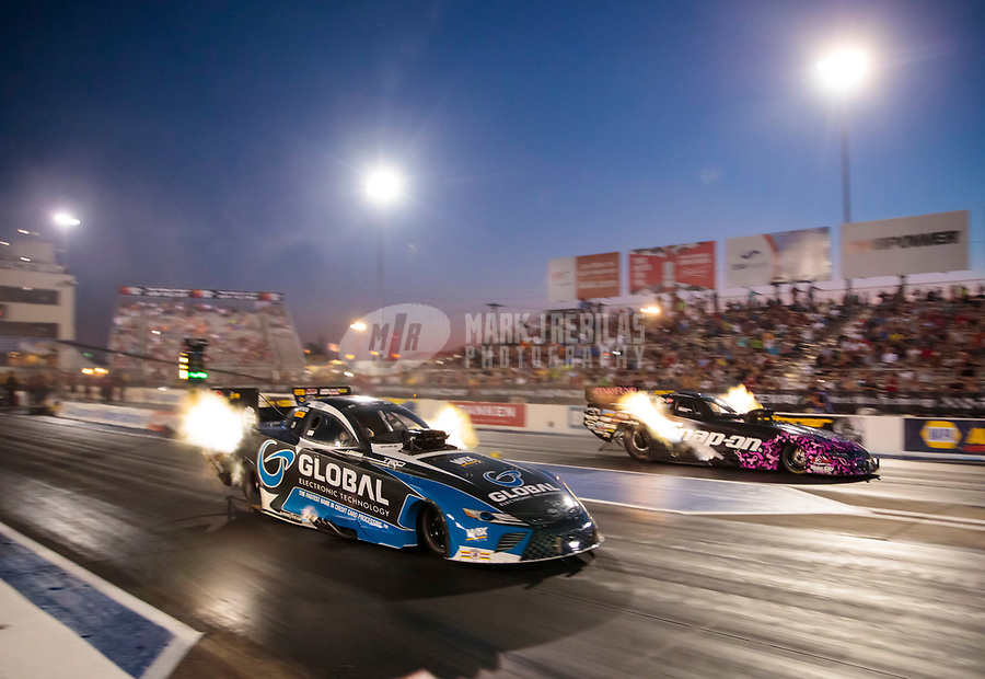 Sep 27, 2019; Madison, IL, USA; NHRA funny car driver Shawn Langdon (Left) races alongside Cruz Pedregon during qualifying for the Midwest Nationals at World Wide Technology Raceway. Mandatory Credit: Mark J. Rebilas-USA TODAY Sports