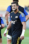 Hurricanes' wing Cory Jane winces as he warms up before taking on the ACT Brumbies in the Super Rugby match at Westpac Stadium, Wellington, New Zealand, Friday, March 07, 2014. Credit: Dean Pemberton