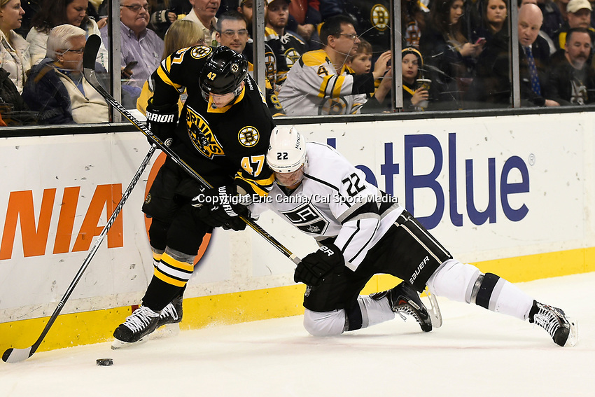 January 31, 2015 - Boston, Massachusetts, U.S. - Boston Bruins defenseman Torey Krug (47) and Los Angeles Kings center Trevor Lewis (22) work for the puck during the second period of the NHL game between the Los Angeles Kings and the Boston Bruins held at TD Garden in Boston Massachusetts.  Eric Canha/CSM