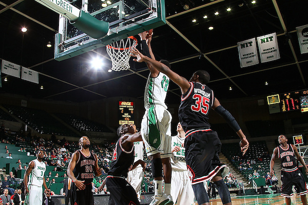 Frisco, TX - FEBRUARY 28: Jordan Williams #23 of the North Texas Mean Green drives in for two points against Kelvin Downs #14 and Raeford Worsham #35 of the Arkansas State Red Wolves at the UNT Coliseum on February 28, 2013 in Denton, Texas. (Photo by Rick Yeatts)
