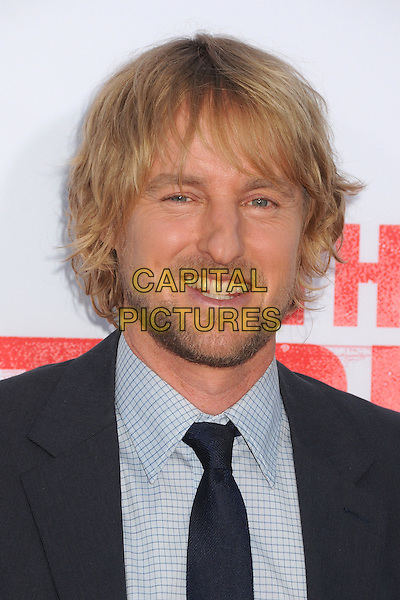 Owen Wilson<br /> &quot;The Internship&quot; Los Angeles Premiere held at the Regency Village Theatre, Westwood, California, USA.<br /> May 29th, 2013<br /> headshot portrait shirt check tie stubble facial hair beard suit blue<br /> CAP/ADM/BP<br /> &copy;Byron Purvis/AdMedia/Capital Pictures