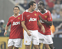 Javier Hernandez #14 and Danny Welbeck #19 of Manchester United with Darron Gibson #28 after he had scored from a free kick during the 2010 MLS All-Star match against the MLS All-Stars at Reliant Stadium, on July 28 2010, in Houston, Texas. Manchester United won 5-2.