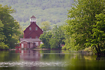 A red mill reflected in the Squam River, Ashland, Lakes Region, NH, USA