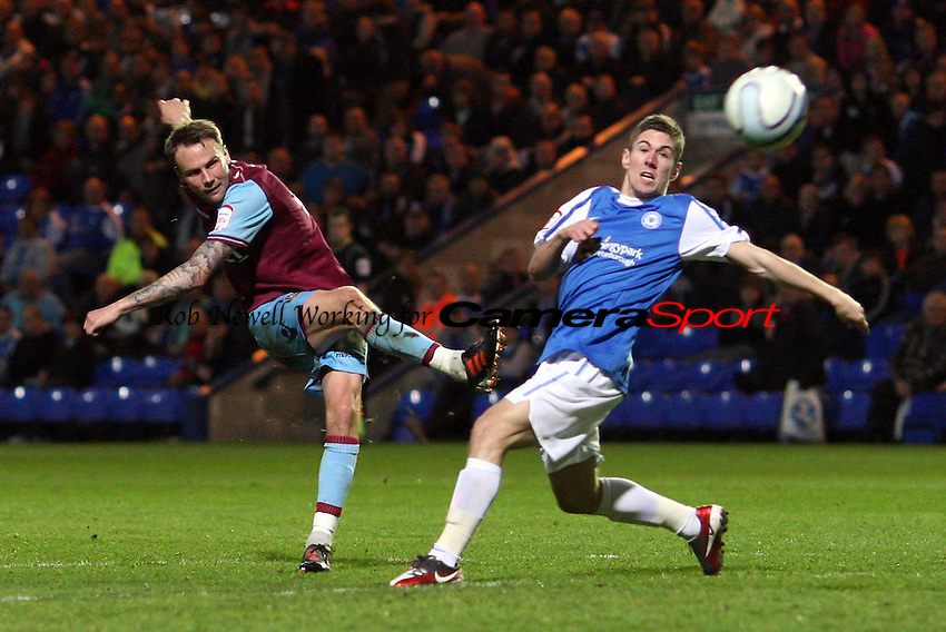 Matt Taylor of West Ham gets in a 2nd half shot - Peterborough United vs West Ham United, npower Championship at London Road, Peterborough - 27/03/12 - MANDATORY CREDIT: Rob Newell/TGSPHOTO - Self billing applies where appropriate - 0845 094 6026 - contact@tgsphoto.co.uk - NO UNPAID USE..