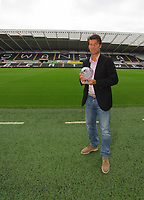 Pictured: Swansea manager Michael Laudrup with the F&C Investments League Managers Association  (LMA)performance of the week award for his team's performance against Queens Park Rangers. Thursday 23 August 2012<br /> Re: Barclay's Premier League side Swansea City FC press conference at the Liberty Stadium, south Wales, UK.