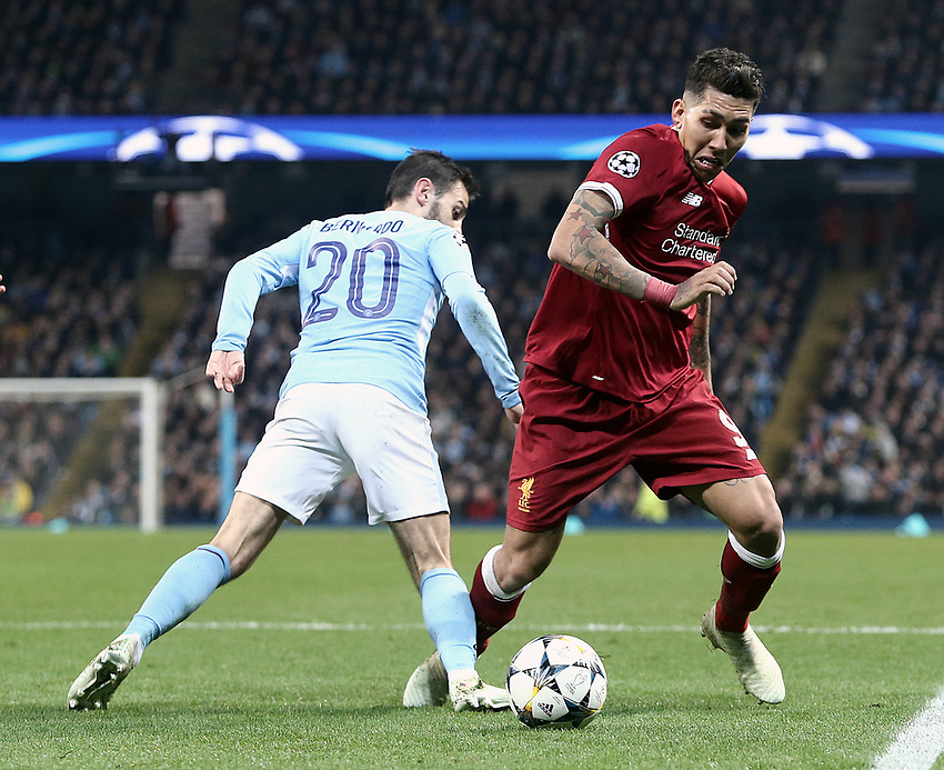 Liverpool's Roberto Firmino gets away from Manchester City's Bernardo Silva<br /> <br /> Photographer Rich Linley/CameraSport<br /> <br /> UEFA Champions League Quarter-Final Second Leg - Manchester City v Liverpool - Tuesday 10th April 2018 - The Etihad - Manchester<br />  <br /> World Copyright &copy; 2017 CameraSport. All rights reserved. 43 Linden Ave. Countesthorpe. Leicester. England. LE8 5PG - Tel: +44 (0) 116 277 4147 - admin@camerasport.com - www.camerasport.com