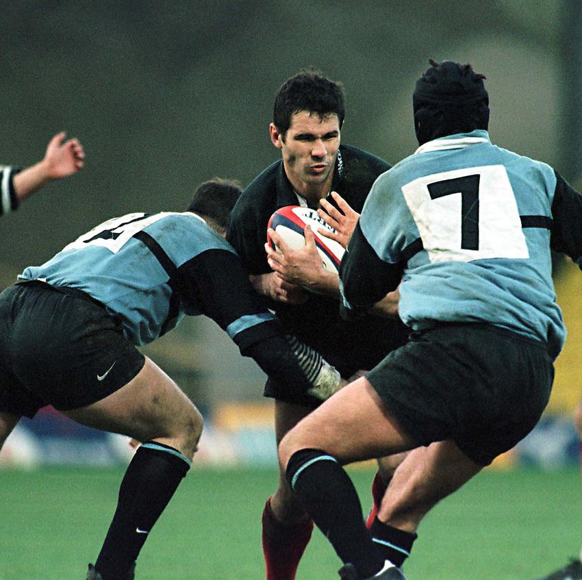 Photo. Richard Lane. .Saracens v Cardiff. 17/1/99..Steve Ravenscroft is stopped by Mathew Wintle (left) and Paul Williams..