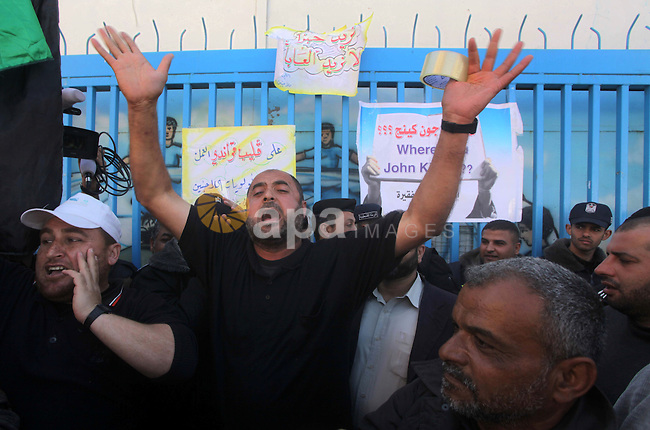 Palestinian refugees protest outside the offices of the United Nations Relief and Works Agency (UNRWA) in Gaza City in demand of undelivered aid supplies on April 15, 2013. The United Nations reopened last week aid distribution centres in Gaza, after a four-day closure in response to the storming of its offices by protesters demanding reinstatement of a monthly cash allowance to poor families which was halted from April 1 due to budget cuts. Photo by Ashraf Amra