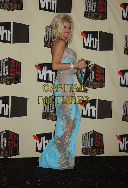 ANNA NICOLE SMITH.VH1 Big in '04 held at the Shrine Auditorium. .December 1st, 2004.full length, blue turquoise dress, see through, see thru, award, trophy.www.capitalpictures.com.sales@capitalpictures.com.© Capital Pictures.