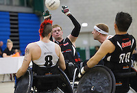 27 MAY 2013 - DONCASTER, GBR - Jim Roberts (second from the left) of West Coast Crash passes during the 2013 Great Britain Wheelchair Rugby Nationals bronze medal match against the South Wales Pirates at The Dome in Doncaster, South Yorkshire .(PHOTO (C) 2013 NIGEL FARROW)