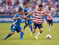 Jose Torres (16) of the United States fights for the ball with Richard Menjivar Peraza (6) of El Salvador during the quarterfinals of the CONCACAF Gold Cup at M&T Bank Stadium in Baltimore, MD.  The United States defeated El Salvador, 5-1.