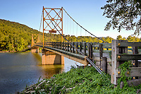 "The ""Little Golden Gate of Arkansas"" as the historic Beaver Bridge near Eureka Springs Arkansas is sometimes called. The historic suspension bridge, is the last one left in Arkansas and was built in 1949 and is 554 feet long and only 11 feet wide, permitting only single lane traffic."