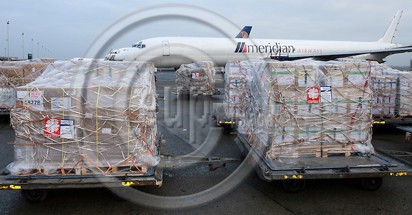 Ostende-Belgium, January 18, 2010 -- CARITAS and 'Diakonie Katastrophenhife' set up a joint cargo flight and distribution of aid supplies after the earthquake in Haiti; here, labelling of pallets at Ostend-Bruges International Airport -- Photo: Horst Wagner / eup-images