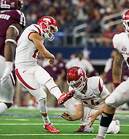 Hawgs Illustrated/Ben Goff<br /> Connor Limpert makes an extra point for Arkansas with Jack Lindsey holding in the 4th quarter vs Texas A&M Saturday, Sept. 29, 2018, during the Southwest Classic at AT&T Stadium in Arlington, Texas.
