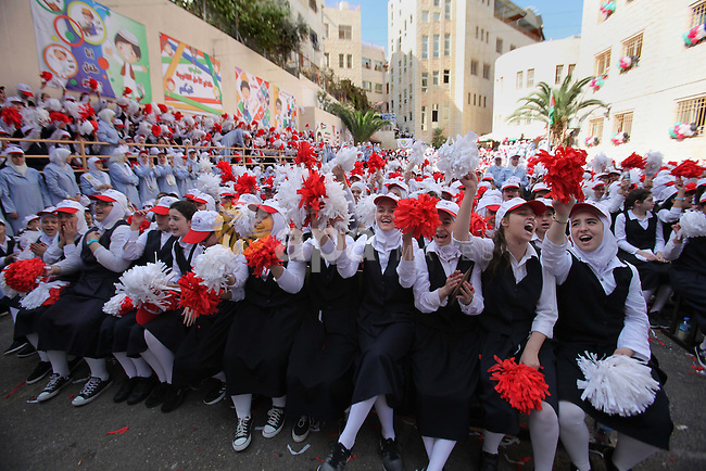 "Palestinian students celebrate after winning the Best School Competition ""challenge the Arab reading"" of the more than 30 thousand schools in the Arab world, in the West Bank city of Nablus, on October 24, 2016. Photo by Nedal Eshtayah"