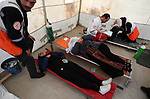 Wounded Palestinian women are treated during clashes with Israeli troops following the tents protest where Palestinians demand the right to return to their homeland at the Israel-Gaza border, in Khan Younis in the southern Gaza Strip, March 08, 2019. A Palestinian youth was killed by Israeli fire as he protested on the frontier of the Gaza Strip and Israel on Friday, and at least 41 other were wounded according to Gaza's health ministry. Photo by Ashraf Amra