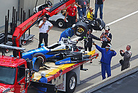 May 28, 2017; Indianapolis, IN, USA; The car of IndyCar Series driver Scott Dixon is towed back to the pits on a flat bed tow truck after an airborne crash during the 101st Running of the Indianapolis 500 at Indianapolis Motor Speedway. Mandatory Credit: Mark J. Rebilas-USA TODAY Sports