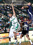 North Texas Mean Green guard Dominique Johnson (1) goes in for a lay up  in the game between the Jackson State Tigers and the University of North Texas Mean Green at the North Texas Coliseum,the Super Pit, in Denton, Texas. UNT defeated Jackson 68 to 49