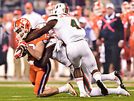 Charlotte, NC - DEC 2, 2017: Clemson Tigers wide receiver Hunter Renfrow (13) is tackeled by Miami Hurricanes defensive back Jaquan Johnson (4) and Dee Delaney (3) during ACC Championship game between Miami and Clemson at Bank of America Stadium Charlotte, North Carolina. (Photo by Phil Peters/Media Images International)