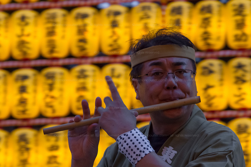 Nebuta dancers and musicians perform during the Mitama matsuri at the controversial Yasukuni Shrine in Kudanshita, Tokyo, Japan. Friday July 14th 2017. The Mitama Matsuri is one of Japan's largest Obon festivals with over 300,000 visiting the shrine to pay respect to ancestors during the 4 days it lasts. Obon is festival of remembrance for ancestors who are believed to come back from the other world and visit the living at this time. Yasukuni Shrine, which houses the spirits of the Japanese war dead, celebrates these spirits with 30,00 yellow lanterns and mikoshi parades and traditional dancing. The festivals runs from July 13th to 16th.