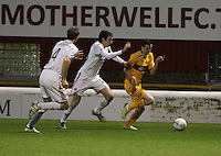 Jamie Murphy getting away from Joe Shaughnessy as Russell Anderson comes across in the Motherwell v Aberdeen, Clydesdale Bank Scottish Premier League match at Fir Park, Motherwell on 26.12.12.
