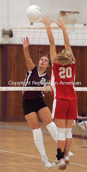 NAUGATUCK, CT - 20 September 2005 -092005JS02--Naugatuck's Jackie Witkoski spikes the ball past Wolcott's Jessica Weyman during their game Tuesday at Naugatuck High School.   --Jim Shannon / Republican-American  -- Wolcott; Jessica Weyman; Naugatuck;, Jackie Witkoski, Naugatuck High School are CQ