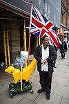 "© Joel Goodman - 07973 332324 . 28/03/2015 . Manchester , UK . A man protesting against the neo-Nazis brought his yellow banana dog and "" Yellow Pride "" Union flag . Approximately 100 neo-Nazis gather in Manchester for "" White Pride Worldwide day "" . Photo credit : Joel Goodman"