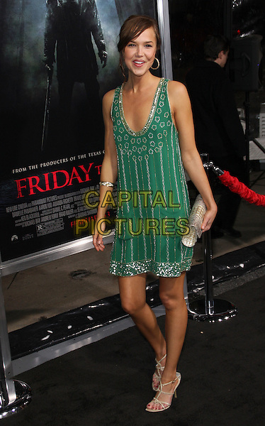 """ARIELLE KEBBEL.""""New Line Cinema and Paramount Pictures present the Los Angeles Premiere of """"Friday the 13th"""" held at Grauman's Chinese Theater, Hollywood, California, USA..February 9th, 2009.full length green silver dress sequins sequined clutch bag .CAP/ADM/KB.©Kevan Brooks/AdMedia/Capital Pictures."""