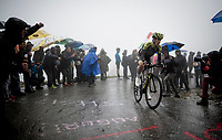 Mikel Nieve (ESP/Mitchelton-Scott) up the extremely wet, cold & misty Cole di Mortirolo <br /> <br /> Stage 16: Lovere to Ponte di Legno (194km)<br /> 102nd Giro d'Italia 2019<br /> <br /> ©kramon