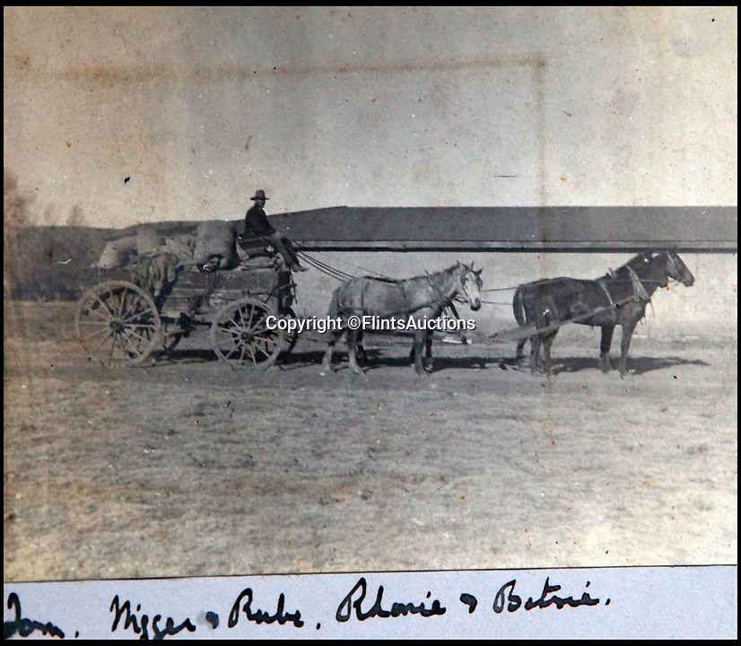BNPS.co.uk (01202 558833)<br /> Pic: FlintsAuctions/BNPS<br /> <br /> With few roads wagons were the main transport.<br /> <br /> Unseen album reveals the life of a cowboy in the real wild west...<br /> <br /> Fascinating previously unseen early photos of cowboys in the Wild West have come to light 130 years later.<br /> <br /> They show life on the ranches of Colorado and New Mexico in the vast expanses of the south west US in the 1880s.<br /> <br /> One dramatic image captures the thrilling moment a group of cowboys ride towards the camera with hats held aloft.<br /> <br /> The photos are thought to have been taken by a British farmhand who travelled Stateside in the late 19th century to earn a living.
