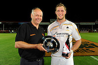 20130801 Copyright onEdition 2013 ©<br /> Free for editorial use image, please credit: onEdition.<br /> <br /> Philip Thitchener (South West Regional Director, J.P. Morgan Asset Management) presents the plate to Richard de Carpentier of Worcester Warriors 7s after winning Pool A of the J.P. Morgan Asset Management Premiership Rugby 7s Series.<br /> <br /> The J.P. Morgan Asset Management Premiership Rugby 7s Series kicks off for the fourth season on Thursday 1st August with Pool A at Kingsholm, Gloucester with Pool B being played at Franklin's Gardens, Northampton on Friday 2nd August, Pool C at Allianz Park, Saracens home ground, on Saturday 3rd August and the Final being played at The Recreation Ground, Bath on Friday 9th August. The innovative tournament, which involves all 12 Premiership Rugby clubs, offers a fantastic platform for some of the country's finest young athletes to be exposed to the excitement, pressures and skills required to compete at an elite level.<br /> <br /> The 12 Premiership Rugby clubs are divided into three groups for the tournament, with the winner and runner up of each regional event going through to the Final. There are six games each evening, with each match consisting of two 7 minute halves with a 2 minute break at half time.<br /> <br /> For additional images please go to: http://www.w-w-i.com/jp_morgan_premiership_sevens/<br /> <br /> For press contacts contact: Beth Begg at brandRapport on D: +44 (0)20 7932 5813 M: +44 (0)7900 88231 E: BBegg@brand-rapport.com<br /> <br /> If you require a higher resolution image or you have any other onEdition photographic enquiries, please contact onEdition on 0845 900 2 900 or email info@onEdition.com<br /> This image is copyright the onEdition 2013©.<br /> <br /> This image has been supplied by onEdition and must be credited onEdition. The author is asserting his full Moral rights in relation to the publication of this image. Rights for onward transmission of any image or file is not granted or implied. Changing or deleting Copyright information is illegal as specified in the Copyright