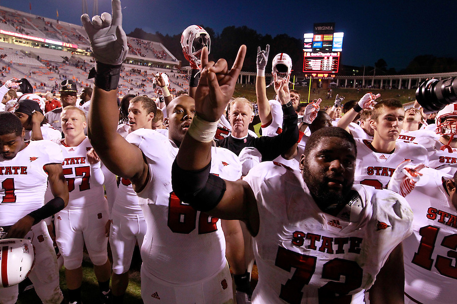 Oct. 22, 2011 - Charlottesville, Virginia - USA; North Carolina State Wolfpack celebrate with their fans during an NCAA football game against the Virginia Cavaliers at the Scott Stadium. NC State defeated Virginia 28-14. (Credit Image: © Andrew Shurtleff