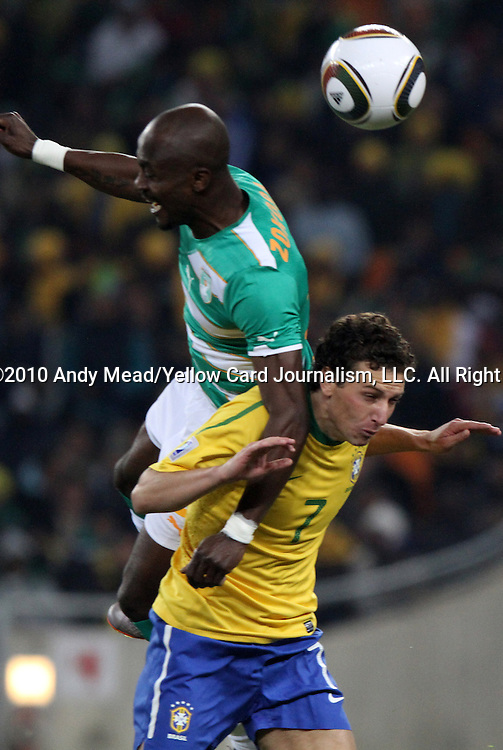 20 JUN 2010: Didier Zokora (CIV) (above) jumps over Elano (BRA) (7). The Brazil National Team defeated the C'ote d'Ivoire National Team 3-1 at Soccer City Stadium in Johannesburg, South Africa in a 2010 FIFA World Cup Group G match.