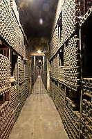 Bottles of vintage wine stored in the original nineteenth century 'Cathedral' wine cellar beneath the Marques de Riscal wine complex and hotel