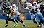 Seattle Seahawks quarterback Matt Flynn scrambles against Tennessee Titans defensive tackle Zach Clayton at CenturyLink Field in Seattle, Washington on August 11, 2012. ©2012. Jim Bryant Photo. All Rights Reserved...