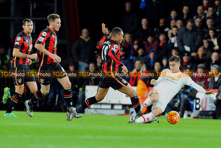 Andreas Pereira of Manchester United makes a tackle on Junior Stanislas of AFC Bournemouth during AFC Bournemouth vs Manchester United at the Vitality Stadium