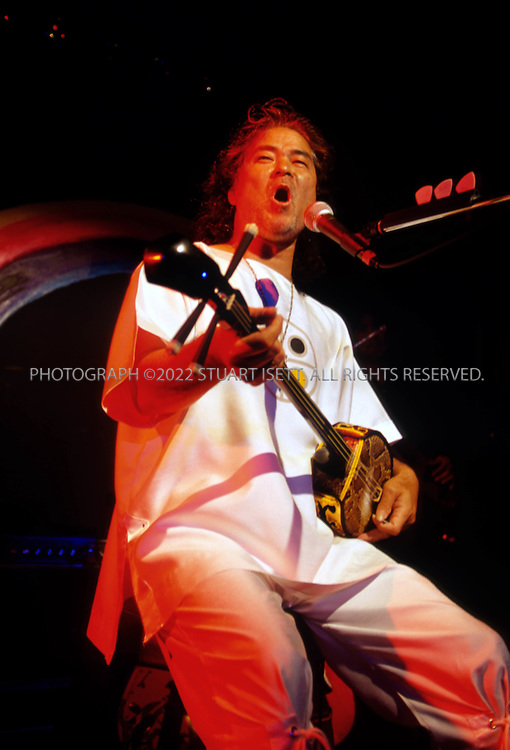 8/8/2001--Naha, Okinawa, Japan..Okinawan singer and politcal activist Shoukichi Kina performing in Naha City....All photographs ©2003 Stuart Isett.All rights reserved.This image may not be reproduced without expressed written permission from Stuart Isett.