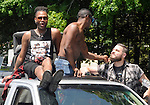 Kiley J. Winn (wearing shirt) and Marquis Evans (bare chested) of Superior Sounds, of Poughkeepsie,  seen at the Hudson Valley LGBTQ's  Annual Gay Pride Parade, held in New Paltz, NY, on Sunday June 7, 2015. Photo by Jim Peppler. Copyright Jim Peppler 2015.