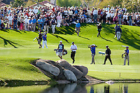 Multitues of 6 to 10 deep gather on the final green of The 2010 Bob Hope Classic to witness Bill Haas win his first PGA event in La Quinta's PGA West Palmer Private golf course.