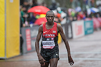 Geoffrey Kamworor of Kenya appears overcome after winning the IAAF World Half Marathon Championships 2016 in Cardiff, Wales on 26 March 2016. Photo by Mark  Hawkins / PRiME Media Images.