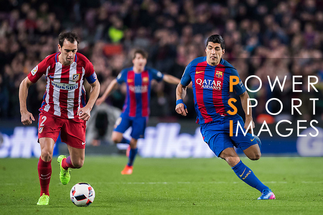 Diego Roberto Godin Leal (l) of Atletico de Madrid is chased by Luis Suarez of FC Barcelona during their Copa del Rey 2016-17 Semi-final match between FC Barcelona and Atletico de Madrid at the Camp Nou on 07 February 2017 in Barcelona, Spain. Photo by Diego Gonzalez Souto / Power Sport Images