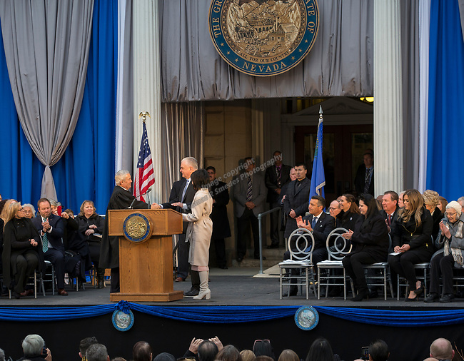 Governor-elect Steve Sisolak, right, with wife Kathy is sworn into office by Nevada Supreme Court Justice Hardesy on the steps of the Nevada State Capitol in Carson City, Nev., Monday, Jan. 7, 2019. (AP Photo/Tom R. Smedes)