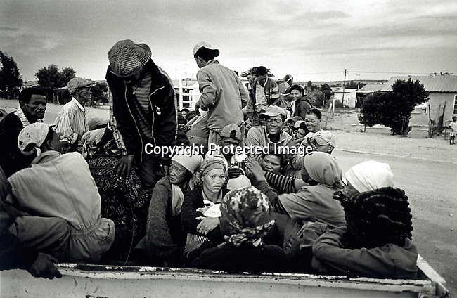 disiabu00060.Social Issues. Abuse. Farmworkers going to work on an open truck on February 28, 2002 in Loisvale, Upington in South Africa. These workers are paid about  $30 a month Baby Thsepang, an 8 month old baby was brutally raped in October- 2001 in the area. In South Africa, some people think that having sex with a virgin or an old woman cleanses yourself from HIV/Aids. A big increase of rapes against children and elederly women has been seen the last years. About 22.000 cases of rapes of children was reported to the police during 2001..©Per-Anders Pettersson/iAfrika Photos