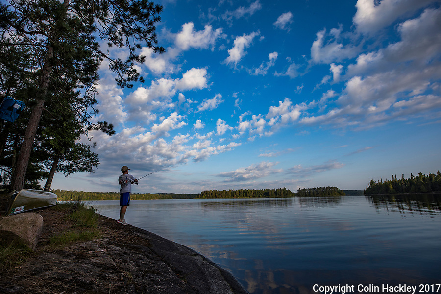 BWCA, MN, 7/30/17-A young man makes a few casts before breakfast at a camp on Sunday Bay of the Boundary Waters Canoe Area's Crooked Lake.<br /> <br /> <br /> COLIN HACKLEY PHOTO
