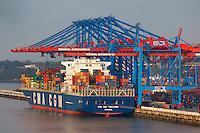 Am Burchardkai liegt die Thalassai: EUROPA, DEUTSCHLAND, HAMBURG, (EUROPE, GERMANY), 14.01.2012 Der HHLA Container Terminal Burchardkai ist die groesste und aelteste Anlage für den Containerumschlag im Hamburger Hafen. Hier, wo 1968 die ersten Stahlboxen abgefertigt wurden, wird heute etwa jeder dritte Container des Hamburger Hafens umgeschlagen. 25 Containerbruecken arbeiten an den Tausenden Schiffen, die hier jaehrlich festmachen, und taeglich werden mehrere Hundert Eisenbahnwaggons be- und entladen. Mit dem laufenden Aus- und Modernisierungsprogramm wird die Kapazitaet des Terminals in den kommenden Jahren schrittweise ausgebaut..Die Thallassa. Dieses moderne, bei der koreanischen Daewoo Werft erbaute, Containerschiff wurde 2008 in Dienst gestellt. Sie ist 345 Meter lang, 45 Meter breit und kann bis zu 11038 Container laden. Sie faehrt unter der Flagge von Zypernmit internationaler Schiffsfuehrung